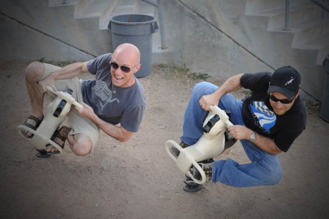 Ruffians acting out their motorcycle passions on helpless playground horses - Composite Image