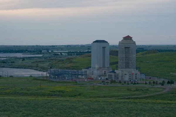 The shock towers above the generating stations of Fort Peck Dam.