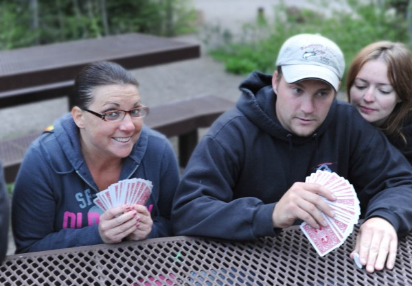 My niece Crystal, nephew Eric, and Sidney who's either spying on Eric's cards or taking a nap.