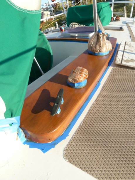 First coat of varnish on the teak. It really started to look good after the third coat!
