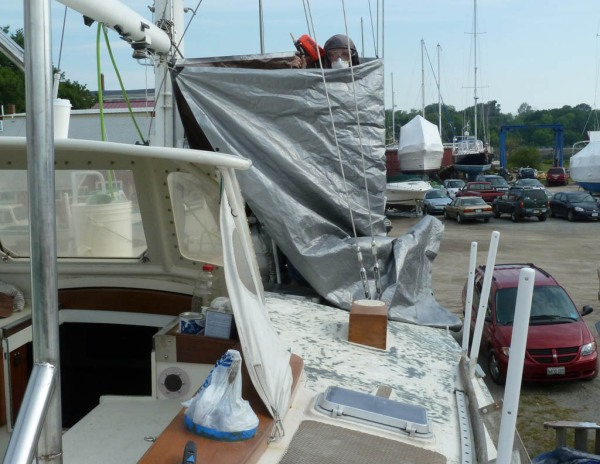 Enclosing an area with tarps and sandblasting around the chainplates.