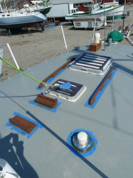 A break in deck painting to sand and varnish the fore-deck teak.