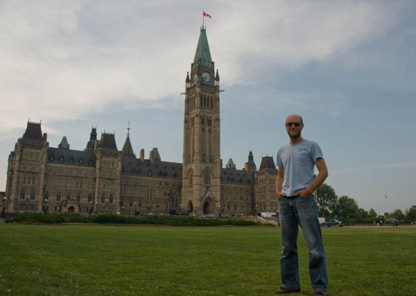 An American ambassador of good cheer awaiting entry into the Édifice du Centre of the Canadian Parliamentary complex, Ottawa