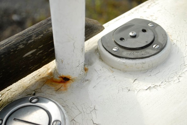 Paint cracking and rusting around the stanchion bases.