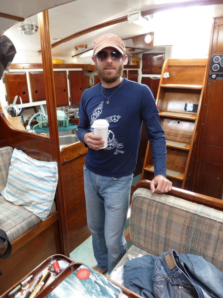 Coffee in hand and ready to remove those toe-rails from the after-deck. (Photo by Kate)