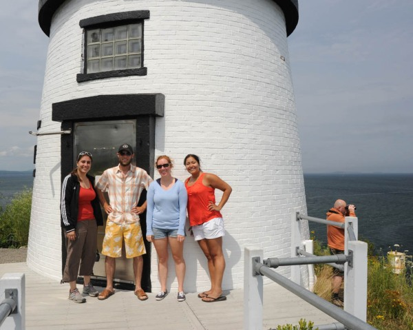 Eugenia, yours truly, Brittany, Adri and a guy wearing an orange jacket at the Owl's Head Light.