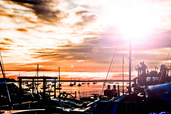 A portentous sunrise from the deck of Northern Cross over the Rockland Harbour, Knight Marine shipyard, and Vinalhaven ferry terminal. - Composite Image.