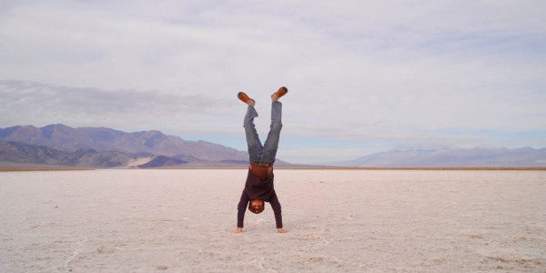 An extremely short lived handstand 286' below sea level on the salt beds of Death Valley. (Photo by Eugenia)