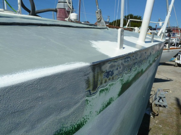 Edge of the deck ground and feathered into the old and new paint, with new white primer following close behind.
