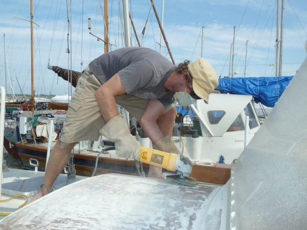 Jason grinding the paint off the hatch cover.
