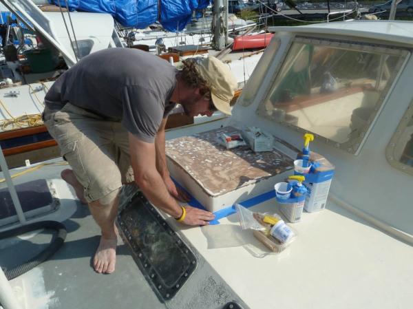Jason masking the areas we hope to keep free of epoxy.
