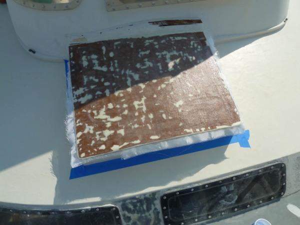 Four new layers of 8 oz fiberglass cloth set in epoxy resin.