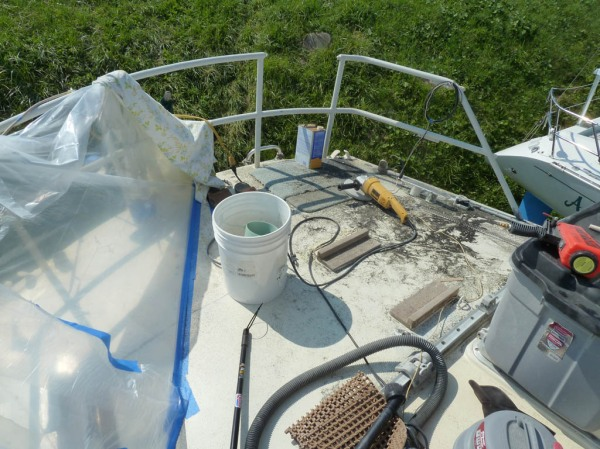 Starboard side details sandblasted and painted (drying under the plastic sheeting), time to start on the port side.