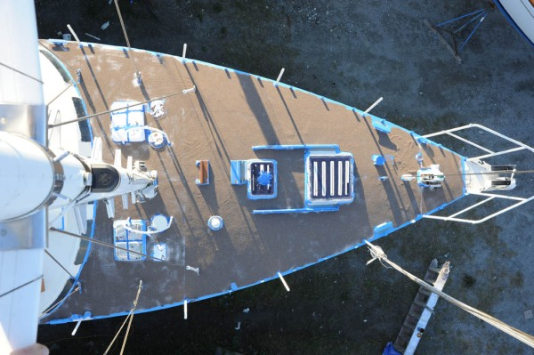 50 pounds of sand spread over an entire foredeck of wet paint.