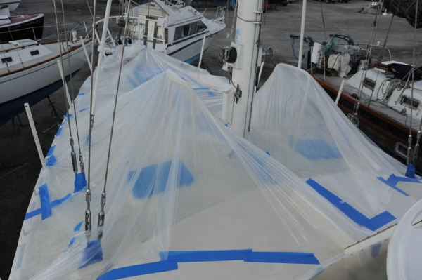 Attempting to keep the dew off the deck the night before the final topcoat was to be applied.