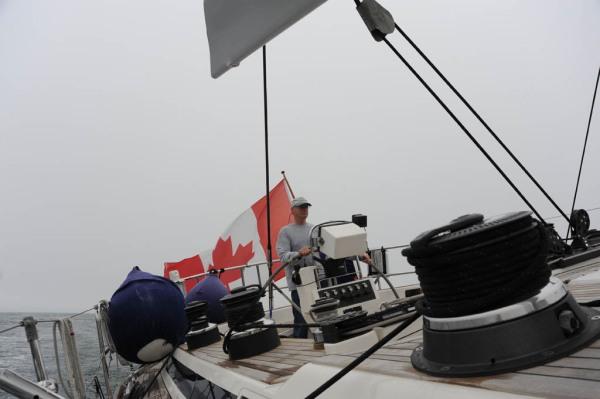 Dad sailing along at a pleasant 8 knots under full main and jib.