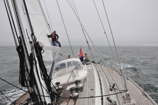 Mom and I standing on the end of the boom while reaching along at 8 knots under full sail and far from the sight of land. I can't say I know many other great-grandmothers who are this adventurous!! (Photo by Dad)