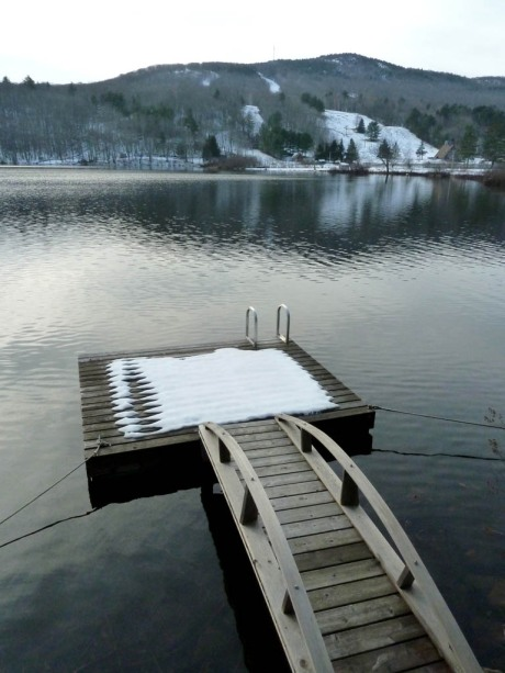 Camden Snow Bowl rising above Hosmer Pond.