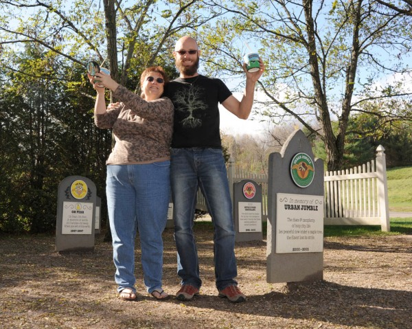 "Taryn and I at the ""Flavor Graveyard"" where homage is paid to all the discontinued Ben & Jerry's flavors. And yes, those are pints we're each holding. And yes, those are Ben & Jerry's pint-sized cozies to keep them cold. Told you we were into our ice cream!"