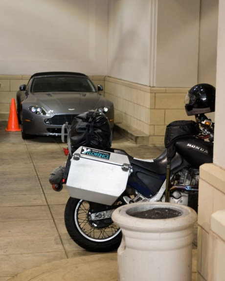 The Camel sharing sleeping quarters with an Aston Martin in the hotel parking garage.