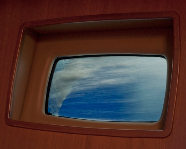 Watching the ocean speed past through a portlight that's usually several feet above the waterline.