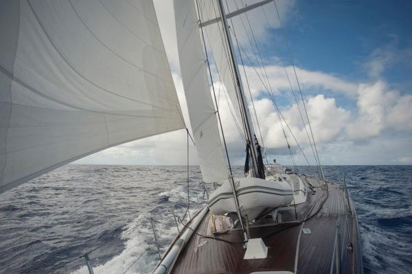 Flying a full main, staysail and jib.