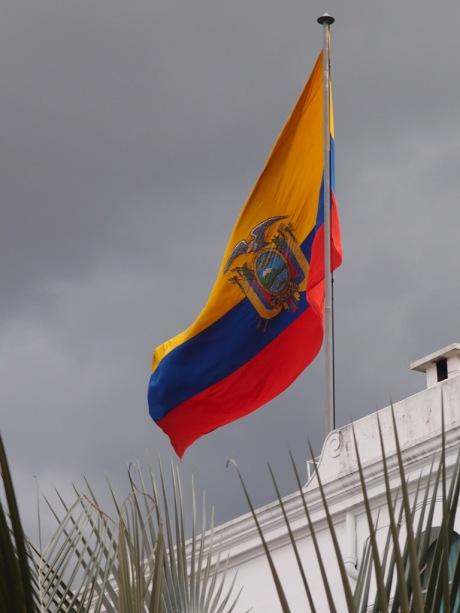 The Ecuadorian flag flies over the Palacio de Gobierno.