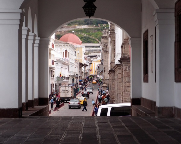 The streets of Quito through the entry hall of the Palacio de Gobierno.