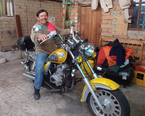 Don Luis showing off Marcello's motorcycle.