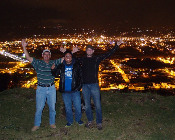 Elvia's husband Oswaldo, son Ivan and I pose high above the city lights of Latacunga.