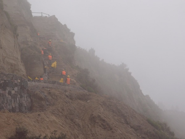 A trail crew improves the steps near the rim of the crater.