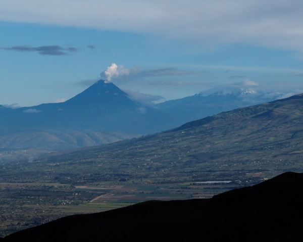 The active Volcán Tungurahua (16,479ft / 5,023m) putting up a cloud of steam. Its last major eruption in 2006 devastated a town, and as recently as last year lava could be seen flowing down its slopes.