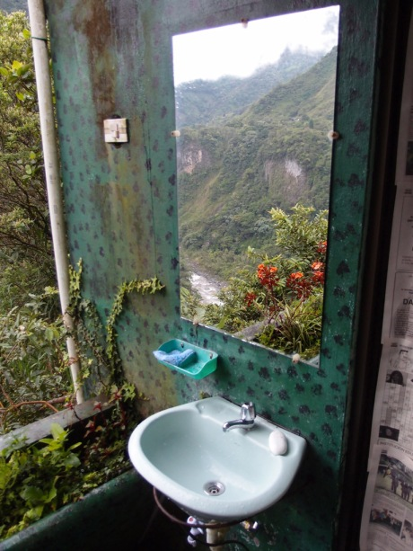 An open air bathroom with quite a view (note the mirror!)