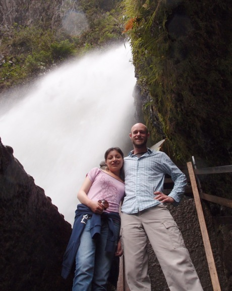 Diana and I stand under the precipice of the Pailón del Diablo waterfalls.