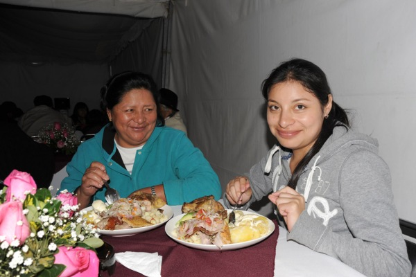 Elvia and Diana enjoying a feast before the dancing begins.