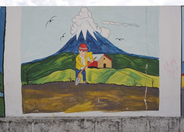 One of many murals on the wall of a local school, this one of the farmlands at the foot of Cotopaxi.