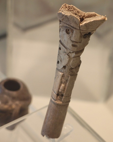 A snuffing tube made from human bone.