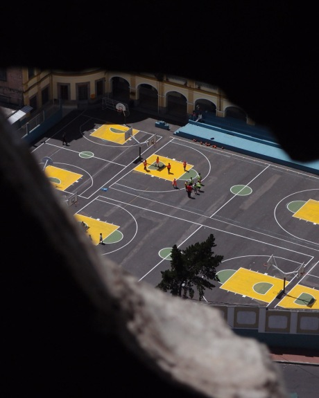 Spying on a game of basketball from the clock tower.