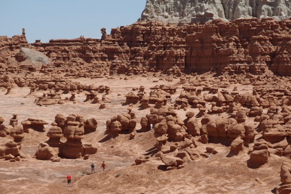 People explore the labyrinth of Goblin Valley.