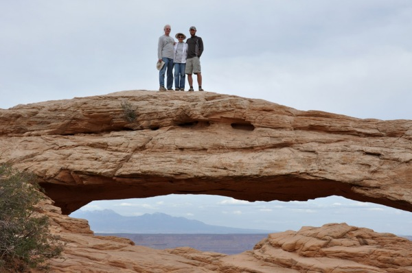 Family portrait on Mesa Arch in Canyonlands.