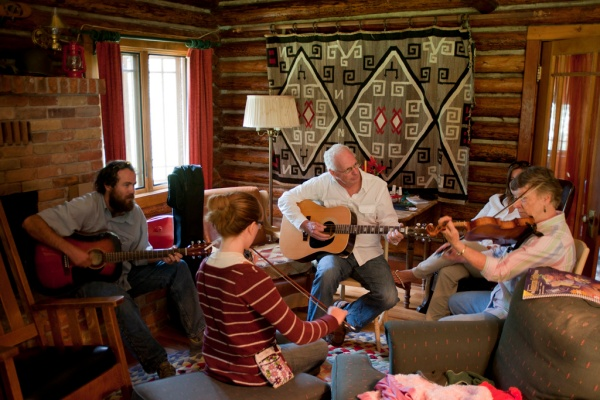 James, Grace, Dad, and Mom serenade the cabin with music.