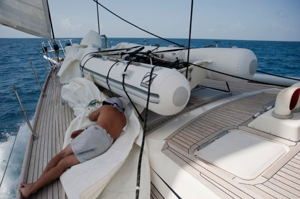 Gary taking a nap in the staysail before his first watch of the passage.