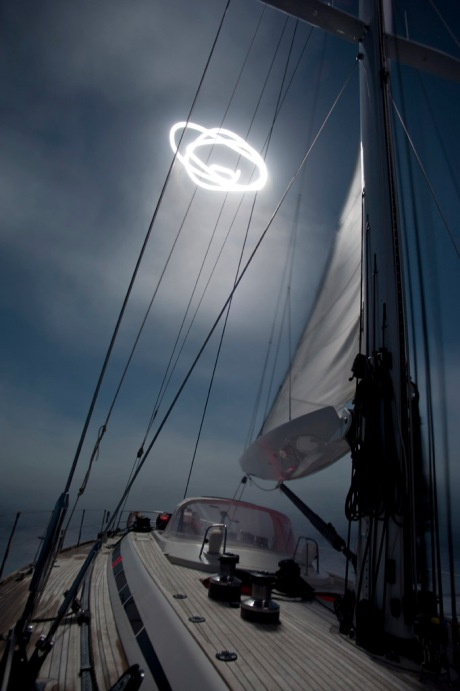 Sailing in rolling seas under a full moon.