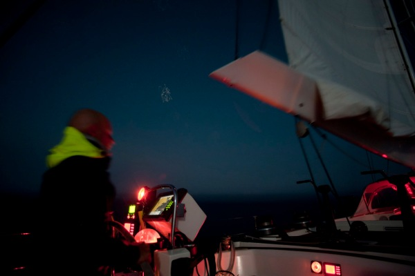 Hand steering under double reefed main and staysail after a small rain squall.