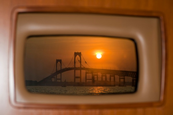 Sunset over the Jamestown Bridge from our cozy anchorage just north of Newport.