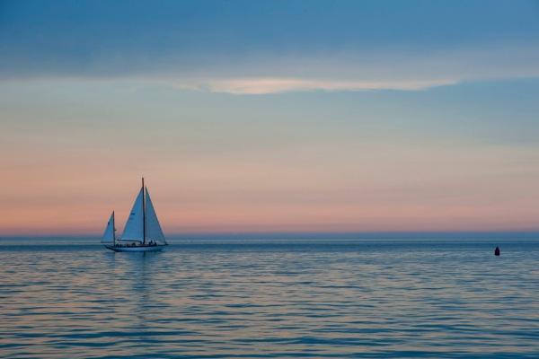 Ghosting along Edgartown Harbor as the sun sets over Martha's Vineyard.