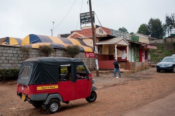 A 3-wheeled tuktuk taxi in the suburbs of Nairobi.