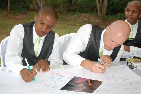 Gachanja and I sign the bridal poster. - Photo by JoeLink Media