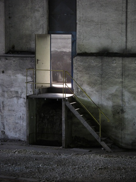 """One of my all time favorite photos. Taken inside an abandoned factory, the light, the shadows, the texture, it speaks of mystery. A visual nod to Ken Kesey's words, """"....there are doors that they're afraid to go in, and they don't want us to go in there either, because if we go in we might learn something that they don't know. And that makes us a little out of their control. """""""