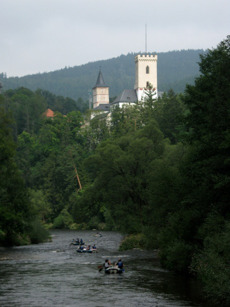 Rafters float along the town of Rožmberk nad Vltavou near the head of the great Vltava River.
